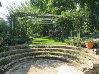 <p>Circular steps going up to garden</p>
