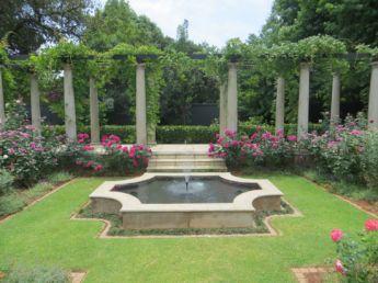 <p>Raised pergola behind pond and rose garden</p>