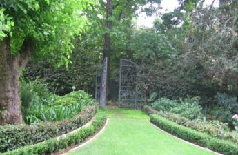 <p>Re-purposed gates found when installing the garden. These were used to create the secret passage</p>