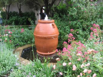 <p>Using a lovely terracotta pot for a water feature</p>