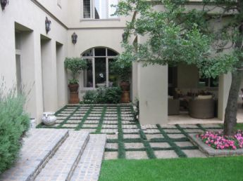 <p>Mondo Grass planted between blocks is an easy way to soften hard surfaces</p>