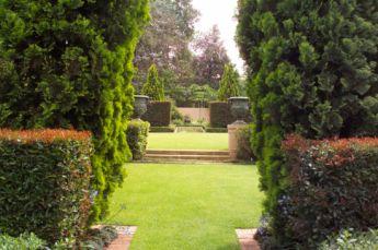 <p>Long vista through the hedges to top garden</p>